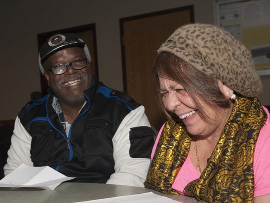 Camden residents Anthony Phoenix, left, and Ana Castellar, smile as they speak about the state Department of Human Services' improvements in its transportation broker contract. This was a three-year effort, and its recent success surprised community activists.