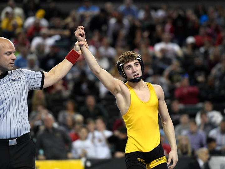 Hanover Park's Joey Olivieri is the 106-pound champion