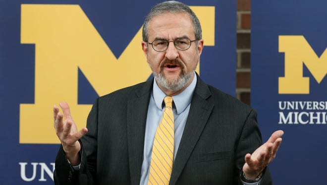 University of Michigan President Mark Schlissel announces that athletic director Dave Brandon resigned during a news conference in Ann Arbor, Mich., Friday, Oct. 31, 2014.