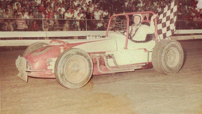 Jim Ford takes the checkered flag in an event in this undated photo.