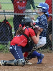 Binghamton catcher Maddie Brink tags out a runner at