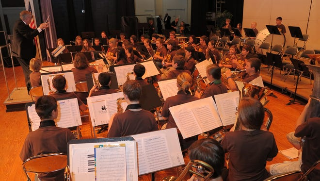 Art Martin works with the Melbourne Municipal Band's youth orchestra.