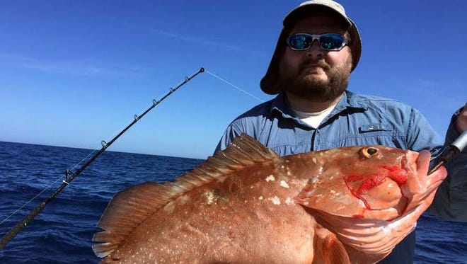 Rory Andraschko used a live pinfish to bait this 18-pound red grouper in 100 feet of water Sunday off Captiva Island, on his Offshore Hunter Charter with Capt. Chris Kreis.