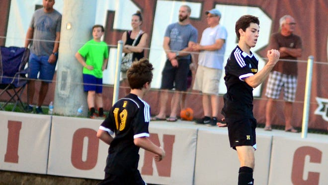 Hendersonville High senior Cole Egan (right) celebrates his second-half goal with freshman Max Cooper during the Commandos' 6-1 victory over Wilson Central on Wednesday evening.