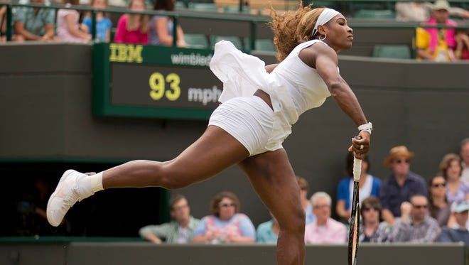 Serena Williams (USA) in action during Thursday's victory against Chanelle Scheepers at Wimbledon.