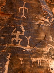 Petroglyphs cover a boulder at the Falling Man Petroglyph site in the Gold Butte Area of Critical Environmental Concern Friday, Jan. 15, 2016.