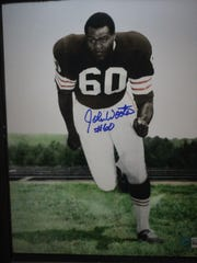 An autographed photo shows John Wooten when he played for the Cleveland Browns, June 16, 2018 at the Carlsbad Hall of Fame.