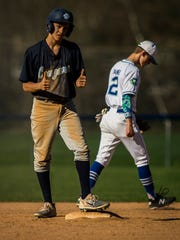 MMU's #11 Mason Combs gives a thumbs up to the base coach after stealing second base during their baseball game Wednesday night, May 9, 2018, against Colchester. MMU won, 8-4.