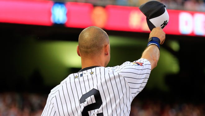 American League All-Star Derek Jeter #2 of the New York Yankees acknowledges the crowd after being pulled in the fourth inning during the 85th MLB All-Star Game at Target Field on July 15, 2014 in Minneapolis, Minnesota.