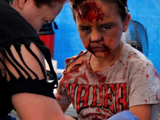 Even children had the chance to get their zombie makeup