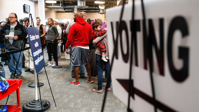 Early voters wait at the Franklin County Board of Elections on Nov. 7, 2016, in Columbus, Ohio.