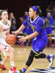 Delaware's Erika Brown passes the ball past Marist's Allie Clement during Thursday's game at Marist College in Poughkeepsie, New York.