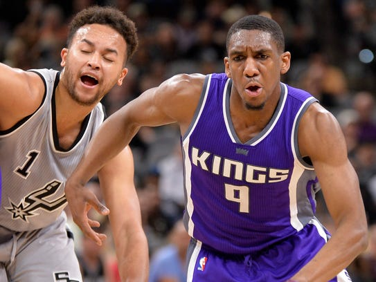 Kings guard Langston Galloway drives around Spurs forward