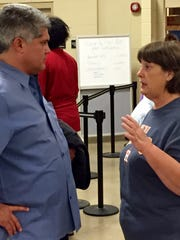 Alexandria Mayor Jacques Roy (left) speaks with evacuee Lydia Pretz from Orange, Texas.