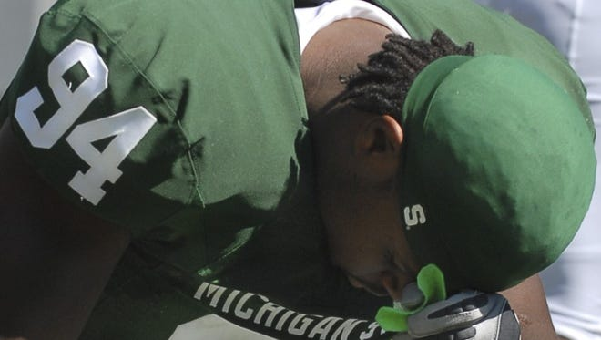 MSU's Jonal Saint-Dic bows his head in prayer before the Sept. 1, 2007, home game against UAB.