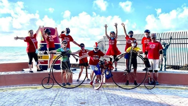 Carleton resident Randy Oleynik and his daughter, Amy, joined the Key West Big Wheel Bike Club after their journey biking from Monroe County to Monroe County, Fla.