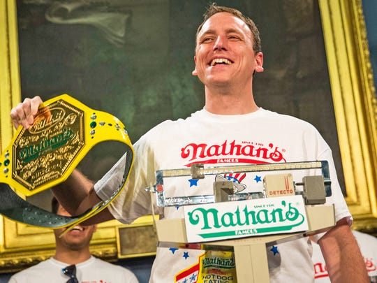 Joey Chestnut consumed 61 hot dogs to win Friday's competition in New York.