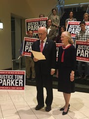 Associate Judge Tom Parker stands with his wife, Dottie, with supporters of his Republican nomination for Alabama Supreme Court Justice on Tuesday, June 5.