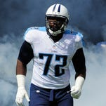 Titans tackle Michael Oher (72) races out of the tunnel as he is introduced before their game against the Browns at LP Field on Sunday Oct. 5, 2014, in Nashville, Tenn.