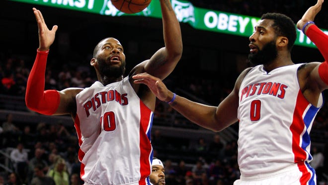 Detroit Pistons forward Greg Monroe, left, gets a rebound next to center Andre Drummond.