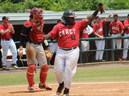 William Carey's James Land gestures to a teammate after