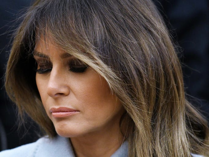 First lady Melania Trump has a pensive look while sitting