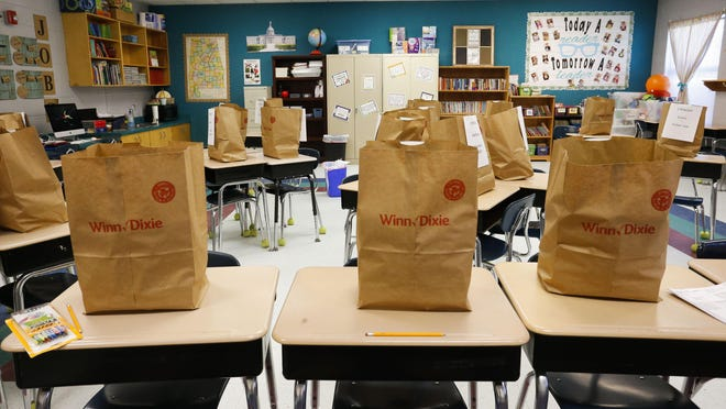 Teachers at Huntington Place Elementary in Northport put together bags of each student's personal supplies and belongings Wednesday, April 1, 2020. They are working to help parents get ready for the at-home school that will resume on Monday.