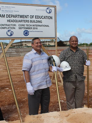 In this June 2012 file photo Gov. Eddie Calvo and Guam Department of Education Superintendent Jon Fernandez stand side-by-side at a groundbreaking ceremony.