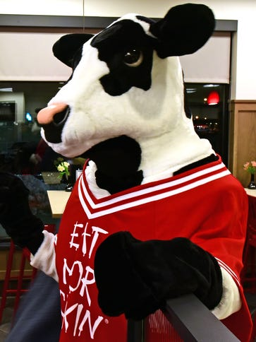 The mascot greets customers early Thursday morning,