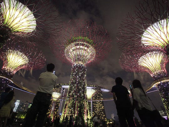 """Gardens by the Bay, seen in 2012, is a park dotted with """"Supertrees,"""" tall structures that function as vertical gardens. A sound and light show plays here twice every evening."""