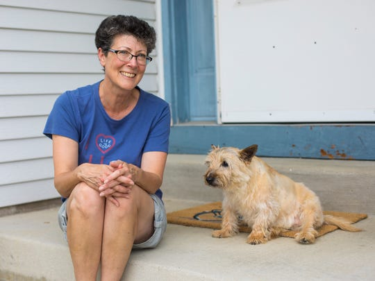 Susan Jacoby of Menomonee Falls is providing a foster home for Robbie, a Scottish terrier whose owner collapsed and died in his garden in May. Robbie, who is at least 10 years old and has trouble walking, stayed with the owner for three days before his body was discovered. A permanent home is being sought for Robbie.