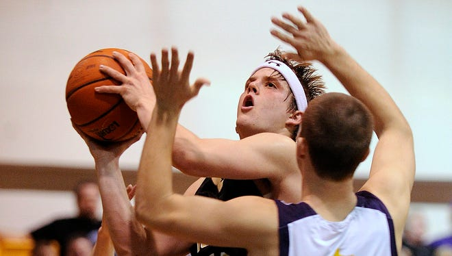 Big Spring's Luke Adams puts up a shot while being defended by Wylie's Donovan Tilley (45) and Mike Furman (20) during the fourth quarter of the Bulldogs' 67-54 win on Friday, Feb. 11, 2011, at Wylie High School.