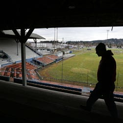 Steve Howard, mechanical division supervisor with the 4J School District, takes a look around Civic Stadium in Eugene, Ore., on Feb. 3, 2014. The stadium burned Monday evening.