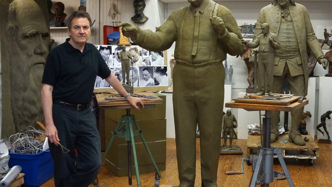 Pennsylvaniaartist Zenos Frudakis stands next to his sculpture of trial lawyer and skeptic Clarence Darrow, who defended a teacher's right to teach evolution in the 1925 Scopes trial. The bronze statue of Darrow will be dedicated Friday on the lawn of the Rhea County Courthouse.