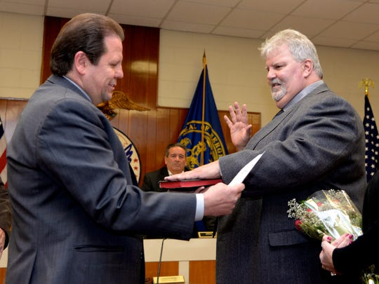Palisades Park Mayor James Rotundo, left, swears in