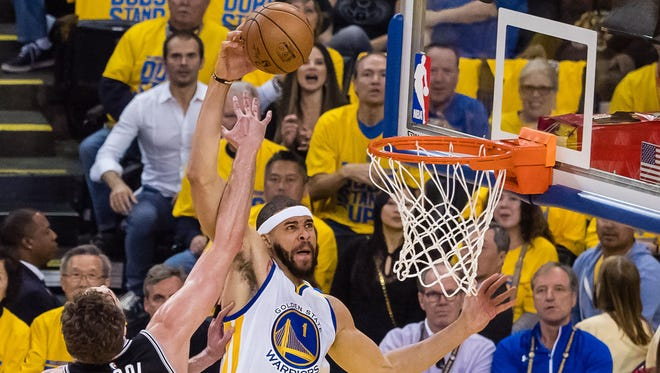 Warriors center JaVale McGee dunks over the Spurs' Pau Gasol during their playoff game last week.