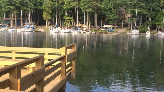 Buncombe County recently built a new fishing pier on Lake Julian, which some parents of youth rowers feel is too close to the dock used by them.