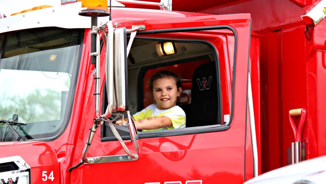 More than 50 service, utility and military vehicles for children to explore will be on display Friday at the Springfield Township Civic Center.