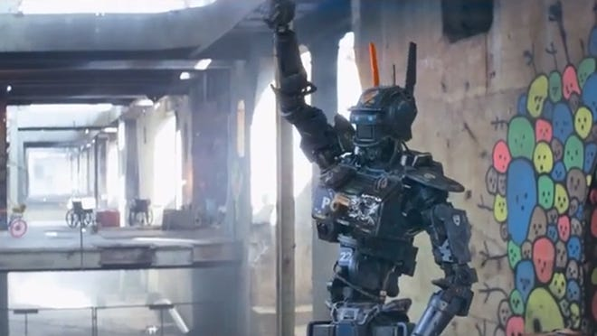 A police robot that begins thinking for itself and developing human feelings presents a problem in Chappie.