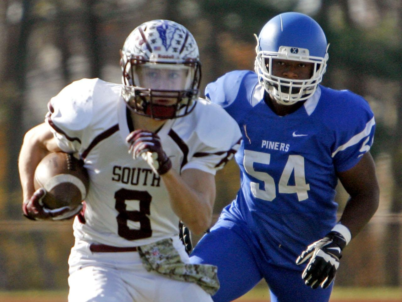 Toms River South's Jason Porter (8) gains yardage at Lakewood High School Nov. 26, 2015. In pursuit is Lakewood's Josh Lezin (54). Photo by Vincent DiSalvio / Special to The ASBURY PARK PRESS