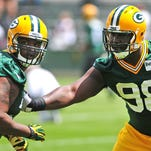 Green Bay Packers defensive end Carlos Gray, left, and defensive tackle Letroy Guion during OTA practice at Ray Nitschke Field.