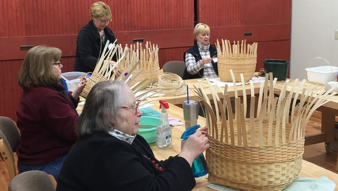 Ingrid Halvorsen of Sister Bay, Anne Kauzlarich of Egg Harbor, Kathy Davis of Sister Bay and Chris Evans of Sister Bay, clockwise from front, weave baskets in a Winter Program class offered by The Clearing Folk School in Ellison Bay. The Clearing holds its annual Student Exhibit of art, crefts and other work created by the past session's students March 3 and 4.