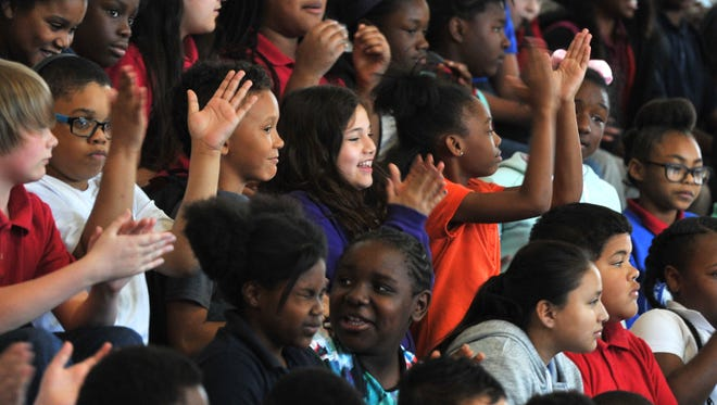 Students at Booker T. Washington cheered as their teachers motivated them to well on the upcoming STAAR test during the STAAR Fiesta pep rally Friday afternoon.