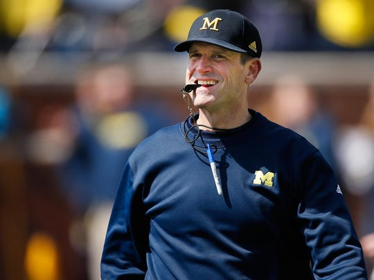 Jim Harbaugh brings his much-hyped Michigan team to