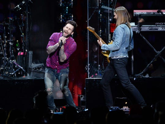 Singer Adam Levine, left, and James Valentine of Maroon 5 perform at Z100 Jingle Ball at Madison Square Garden in New York in December 2014. Atlantic City officials hope that this weekends free concerts on the beach with Maroon 5 and Rascal Flatts bring some much needed revenue into the struggling resort town.