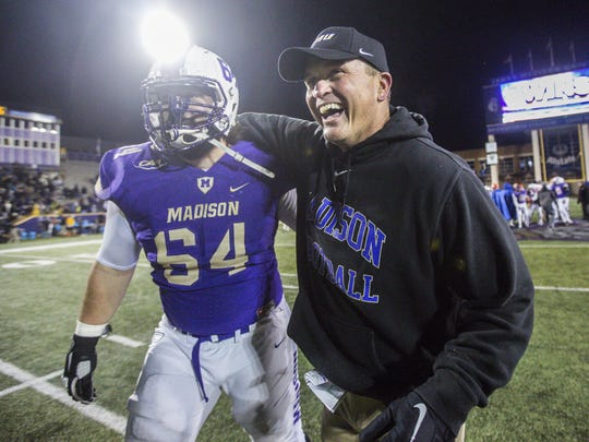 James Madison offensive lineman Matt Frank (64) celebrates with head coach Mike Houston after an NCAA college football game against Sam Houston State in Harrisonburg, Va., Friday, Dec. 9, 2016. (Daniel Lin/Daily News-Record via AP)
