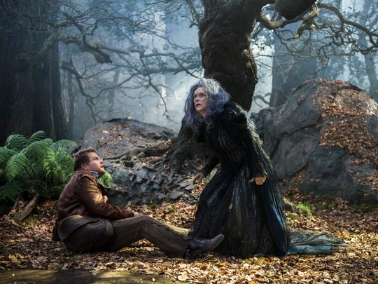 """This image released by Disney shows James Corden, left, and Meryl Streep in a scene from """"Into the Woods,"""" in theaters nationwide on Dec. 25, 2014. (AP Photo/Disney Enterprises, Inc., Peter Mountain)"""
