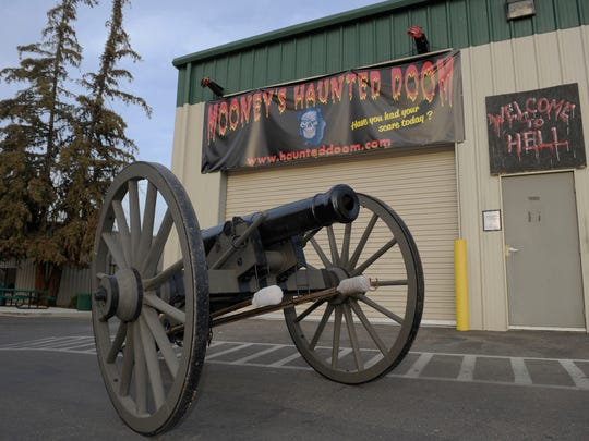 A Civil War-replica cannon is pictured in front of the Haunted Doom in Visalia on Wednesday, October 15, 2014.