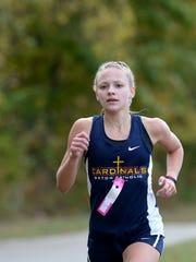 Seton Catholic's Jenna Barker runs in the regional cross country meet Saturday, Oct. 17, 2015, in Rushville.