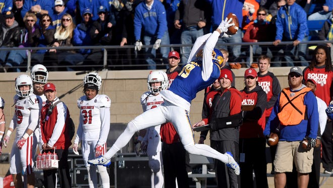 SDSU's Jake Wieneke catches a pass to score a touchdown against USD at Dana J. Dykhouse Stadium on Saturday in Brookings.